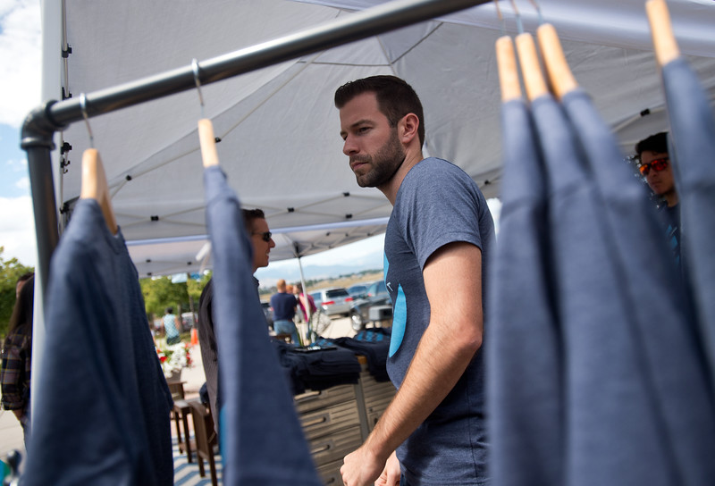 """Young Adult Pastor Michael Berry sells t-shirts to congregants after a worship service at LifeBridge Christian Church in Longmont on Sunday. The t-shirts are being sold to celebrate the church's 125th anniversary. <br /> More photos:  <a href=""""http://www.dailycamera.com"""">http://www.dailycamera.com</a><br /> (Autumn Parry/Staff Photographer)<br /> September 4, 2016"""