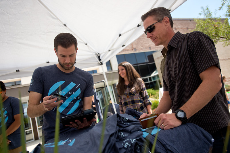 "Young Adult Pastor Michael Berry (left) sells a t-shirt to Chad Elmendorf after a worship service at LifeBridge Christian Church in Longmont on Sunday. The t-shirts are being sold to celebrate the church's 125th anniversary. <br /> More photos:  <a href=""http://www.dailycamera.com"">http://www.dailycamera.com</a><br /> (Autumn Parry/Staff Photographer)<br /> September 4, 2016"