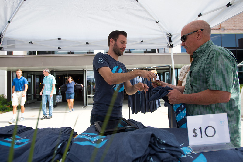 "Young Adult Pastor Michael Berry (left) sells a t-shirt to Al Campbell after a worship service at LifeBridge Christian Church in Longmont on Sunday. The t-shirts are being sold to celebrate the church's 125th anniversary. <br /> More photos:  <a href=""http://www.dailycamera.com"">http://www.dailycamera.com</a><br /> (Autumn Parry/Staff Photographer)<br /> September 4, 2016"