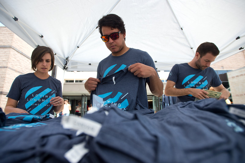 "From left to right, Hanna Koenig, Joe Schneider and Michael Berry sell t-shirts on behalf of the 125th anniversary of LifeBridge Christian Church after a worship service in Longmont on Sunday.  <br /> More photos:  <a href=""http://www.dailycamera.com"">http://www.dailycamera.com</a><br /> (Autumn Parry/Staff Photographer)<br /> September 4, 2016"