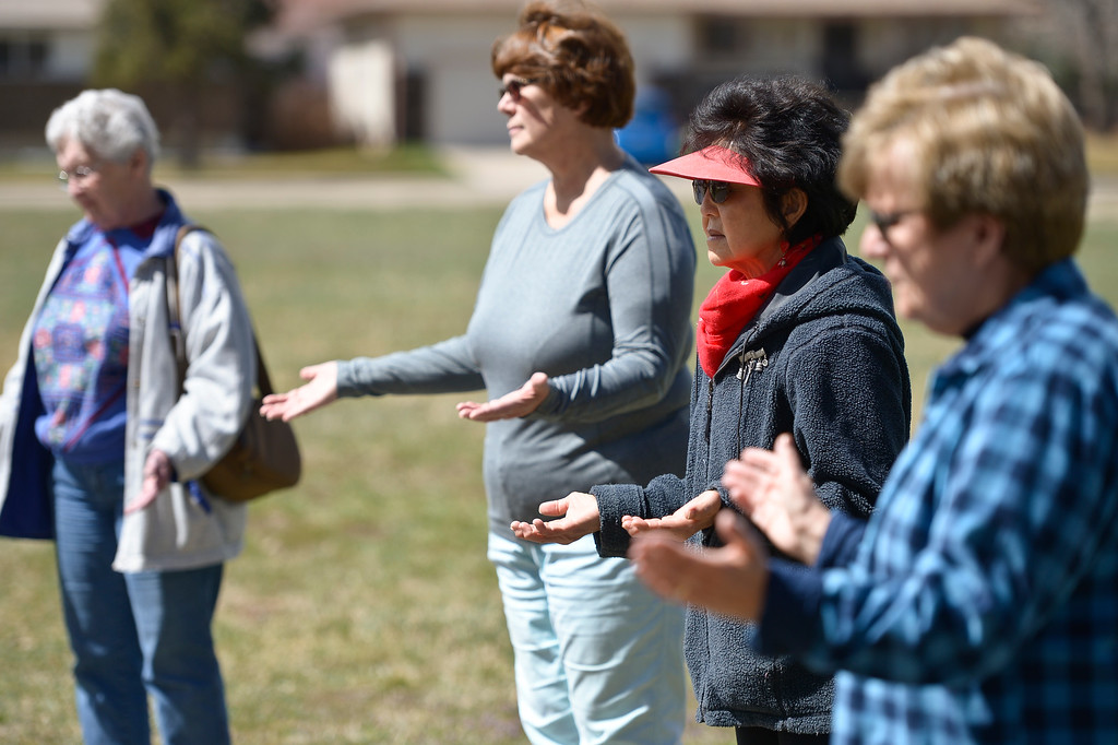 ". Irene Yap, second from right, prays before participating in Light of Christ\'s Good Friday Labyrinth walk at Bethlehem Lutheran Church, 1000 W. 15th Ave. ""(The walk) is this archetype of your life and its twists and turns,\"" said Light of Christ\'s Father Terri Harroun.  To view more photos visit timescall.com.  Lewis Geyer/Staff Photographer March 30, 2018"