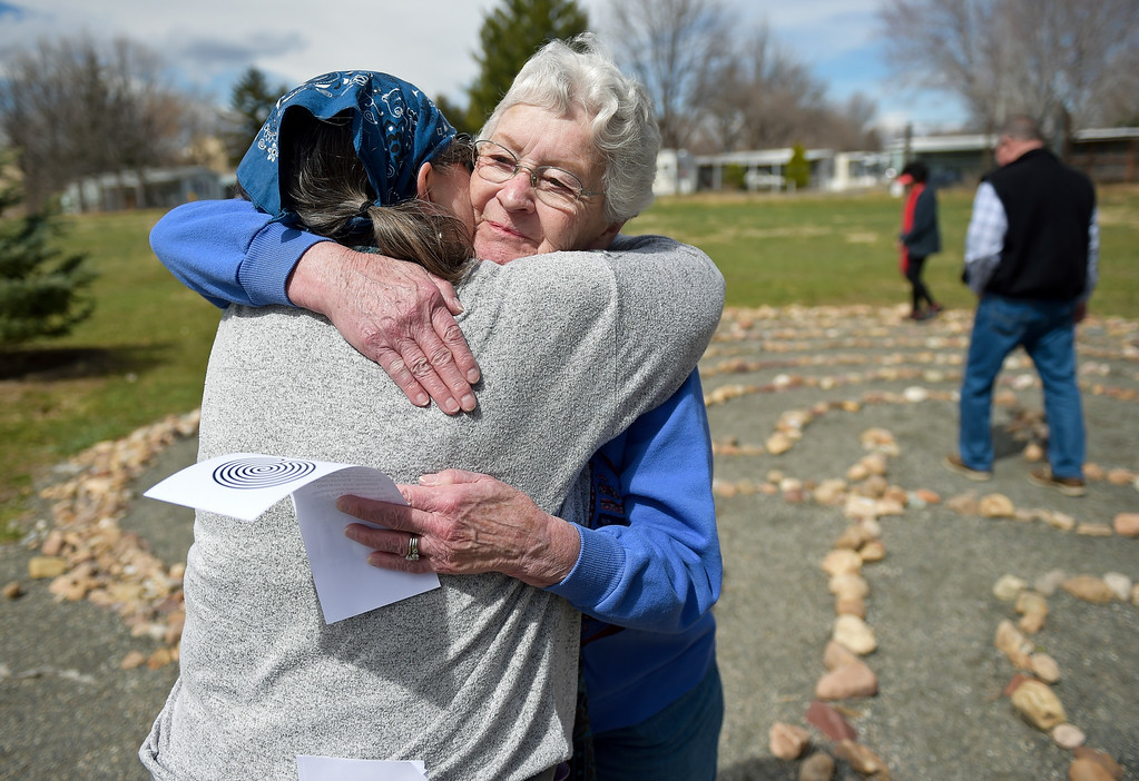 ". Nancy McLeod, right, is embraced by Light of Christ\'s Father Terri Harroun after participating in Light of Christ\'s Good Friday Labyrinth walk at Bethlehem Lutheran Church, 1000 W. 15th Ave. ""(The walk) is this archetype of your life and its twists and turns,\"" Harroun said. To view more photos visit timescall.com.  Lewis Geyer/Staff Photographer March 30, 2018"