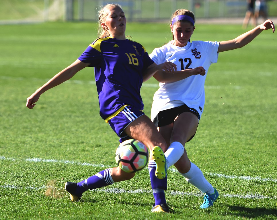 . Silver Creek\'s Alexa Karsel gets a shot off around a defender during the Raptors\' 4A state quarterfinal game against Littleton on Wednesday, May 16, at Silver Creek High School.