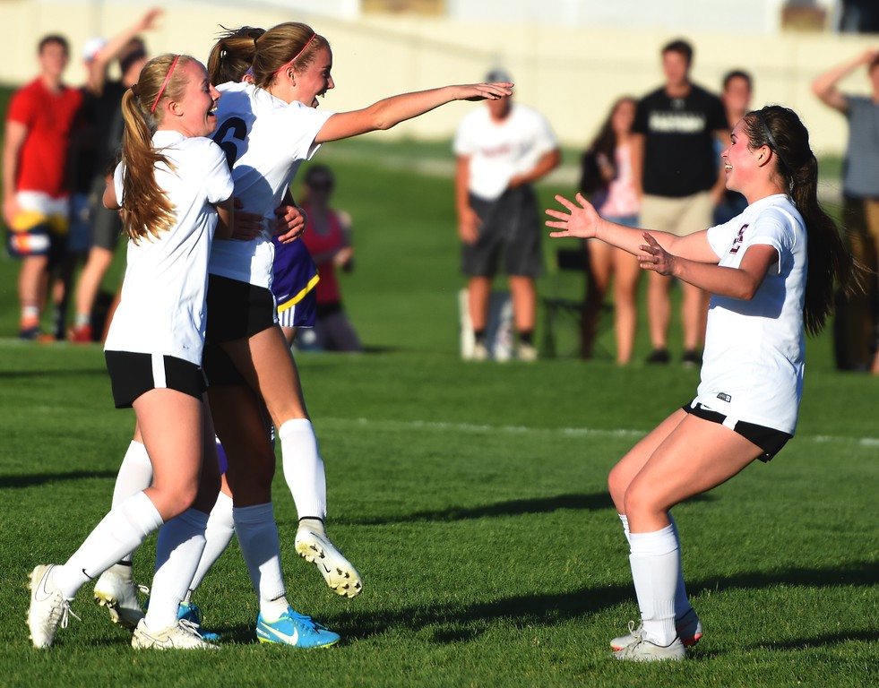 . Silver Creek girls soccer players celebrate the game-winner in overtime during the Raptors\' 4A state quarterfinal game against Littleton on Wednesday, May 16, at Silver Creek High School.