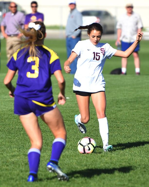 . Silver Creek\'s Emma Blaser looks to pass during the Raptors\' 4A state quarterfinal game against Littleton on Wednesday, May 16, at Silver Creek High School.