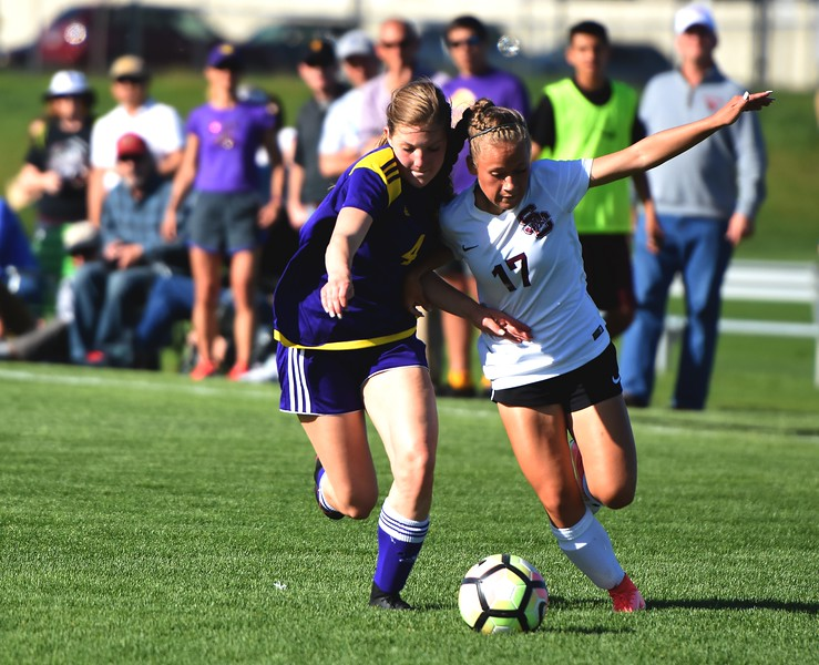 Silver Creek's Jordy Victor races a defender to the ball during the Raptors' 4A state quarterfinal game against Littleton on Wednesday, May 16, at Silver Creek High School.
