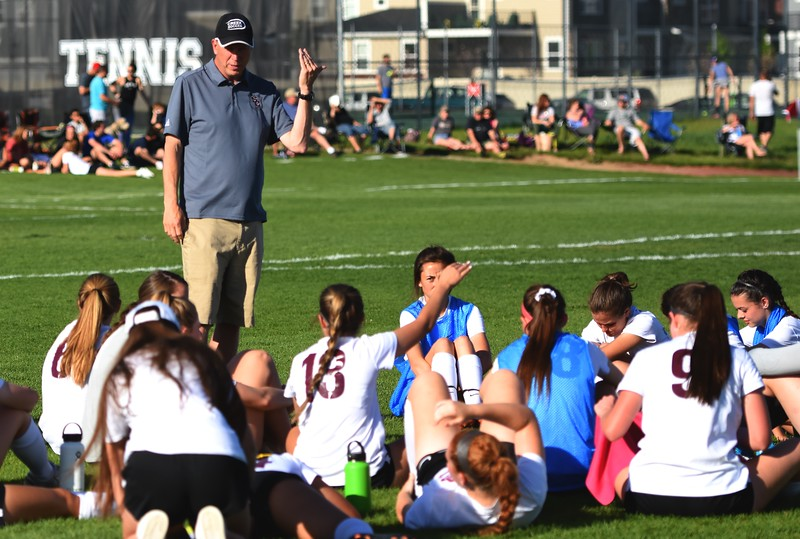 Silver Creek head coach Rob Johnson talks to his team at halftime during the Raptors' 4A state quarterfinal game against Littleton on Wednesday, May 16, at Silver Creek High School.