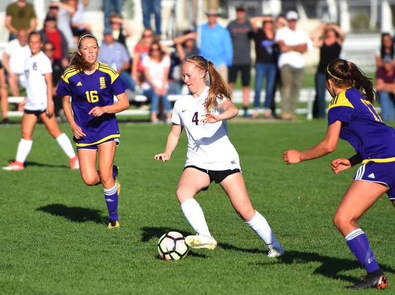 Silver Creek's Annalise Teasdale looks for a way out of traffic during the Raptors' 4A state quarterfinal game against Littleton on Wednesday, May 16, at Silver Creek High School.