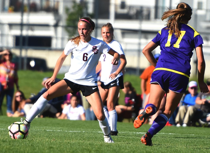 Silver Creek's Kate Eggen controls the ball in the midfield during the Raptors' 4A state quarterfinal game against Littleton on Wednesday, May 16, at Silver Creek High School.