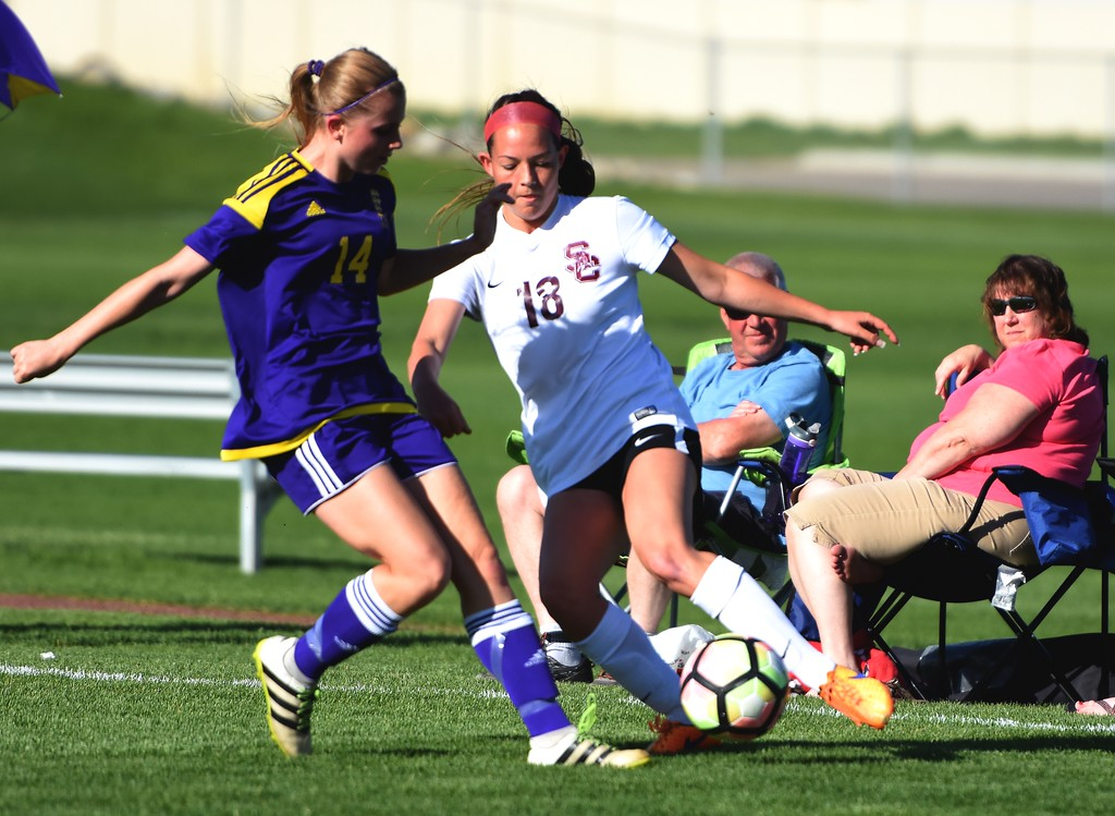. Silver Creek\'s Nadia Ziegler changes directions to avoid a defender during the Raptors\' 4A state quarterfinal game against Littleton on Wednesday, May 16, at Silver Creek High School.