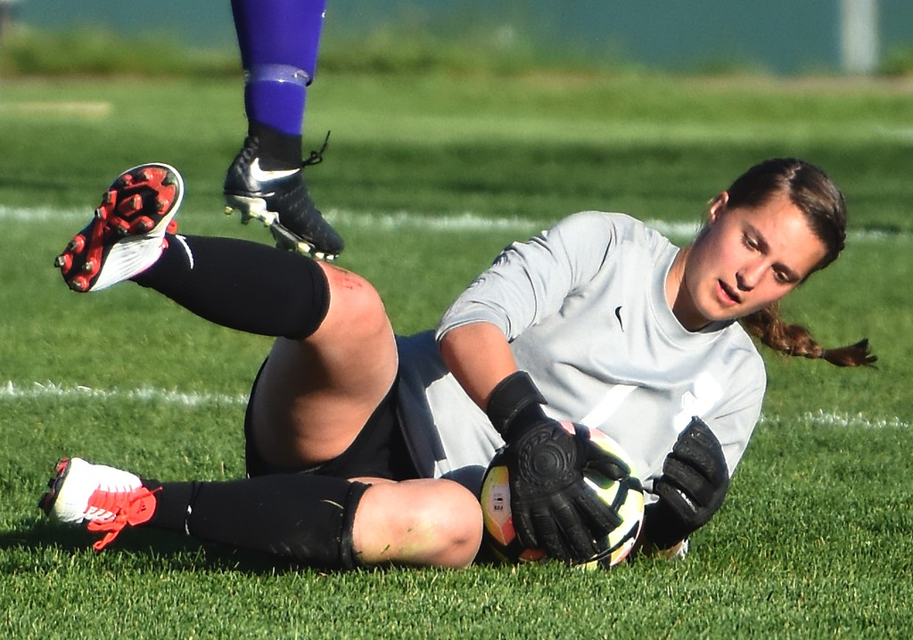 . Silver Creek goalkeeper Kaeyla Noble stops a fast break as a striker passes overhead during the Raptors\' 4A state quarterfinal game against Littleton on Wednesday, May 16, at Silver Creek High School.