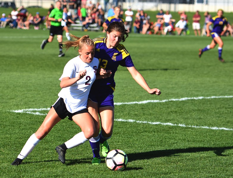 Silver Creek's Annika Kassenbrock fights a defender for the ball during the Raptors' 4A state quarterfinal game against Littleton on Wednesday, May 16, at Silver Creek High School.
