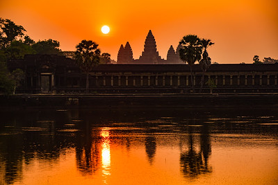 Angkor Wat at dawn with sun reflected in the moat