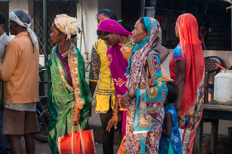 Women waiting at the market, India