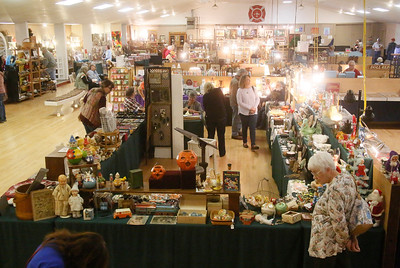 Attendees browse the main floor at the annual Loleta Antique Show in the Loleta Fireman's Pavilion on Friday. The event, a fundraiser for the Loleta Volunteer Fire Department, continues today from 10 a.m. to 6 p.m. and Sunday from  10 a.m. to 4 p.m. (Shaun Walker -- The Times-Standard)