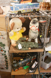Barbara Carey of Blue Lake's items for sale include vintage toys. (Shaun Walker -- The Times-Standard)