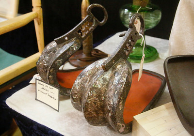 Antique Japanese Samurai stirrups sit for sale at the Armour Antiques of Klamath Falls, Oregon, booth. (Shaun Walker -- The Times-Standard)