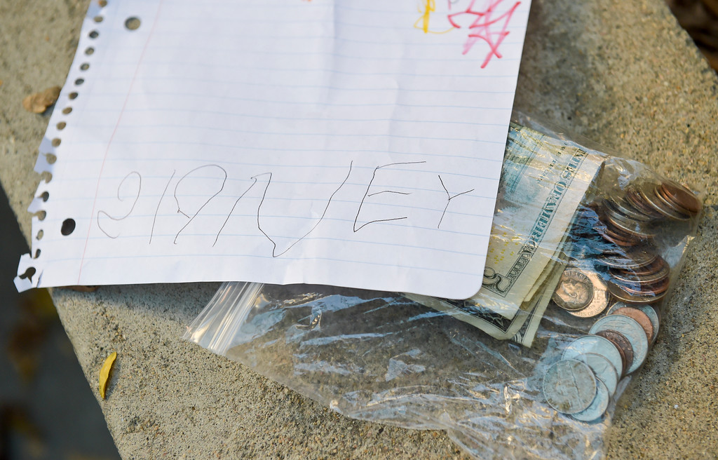 . The money and a letter Sidney Fahrenbruch, 4, donated Tuesday afternoon to a Longmont police officer who has cancer. To view more photos and a video visit timescall.com. Lewis Geyer/Staff Photographer Oct. 24, 2017