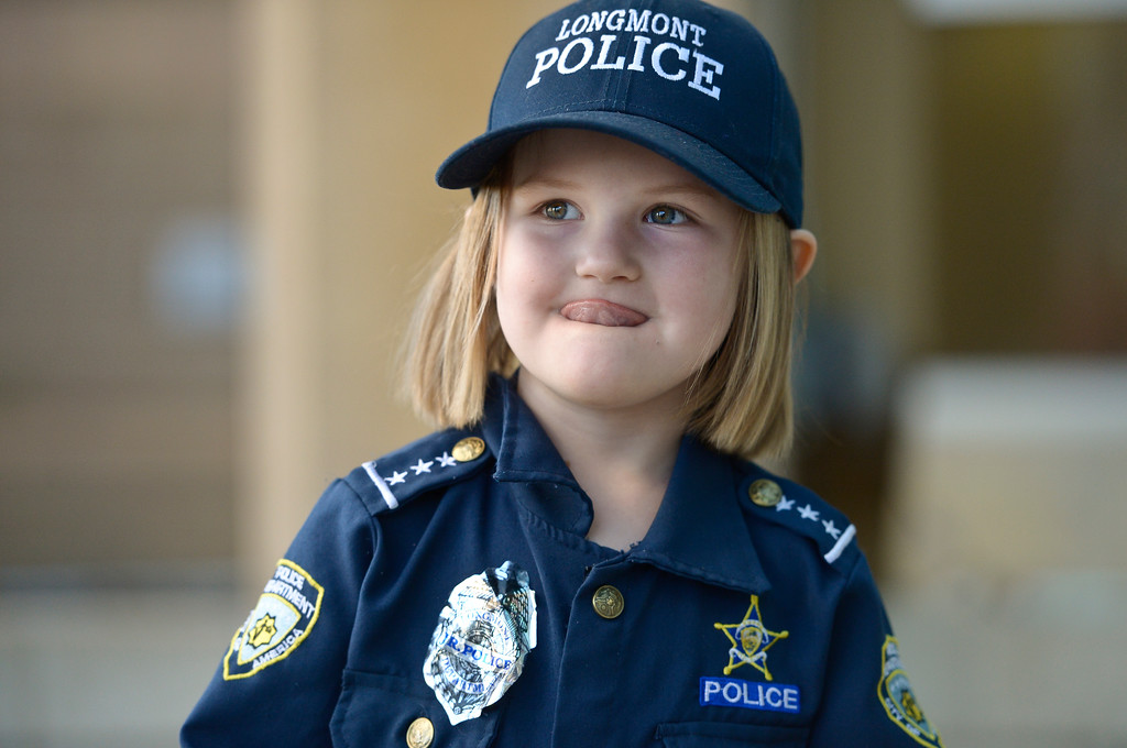 . Sidney Fahrenbruch, 4, came dressed in her police uniform Tuesday afternoon to donate money from her piggy bank to a Longmont police officer who has cancer. To view more photos and a video visit timescall.com. Lewis Geyer/Staff Photographer Oct. 24, 2017