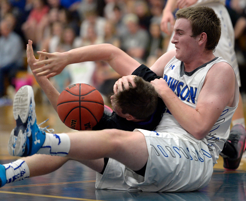 . Longmont Christian\'s Luke Puchino and Dawson\'s Nick Timms battle for a jump ball in the second quarter Thursday night at Alexander Dawson. To view more photos visit bocopreps.com. Lewis Geyer/Staff Photographer Feb. 16, 2017