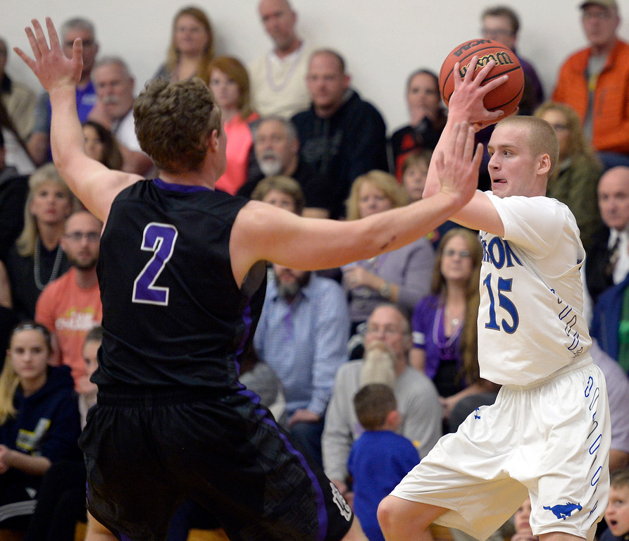 . Dawson\'s Bryce Bickel is covered by Longmont Christian\'s Jackson Solem in the second quarter Thursday night at Alexander Dawson. To view more photos visit bocopreps.com. Lewis Geyer/Staff Photographer Feb. 16, 2017