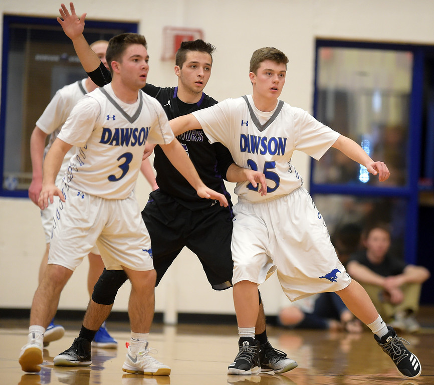 . Longmont Christian\'s Cameron Jauregui is covered by Dawson\'s Jack Shams and Riley Burridge in the second quarter Thursday night at Alexander Dawson. To view more photos visit bocopreps.com. Lewis Geyer/Staff Photographer Feb. 16, 2017