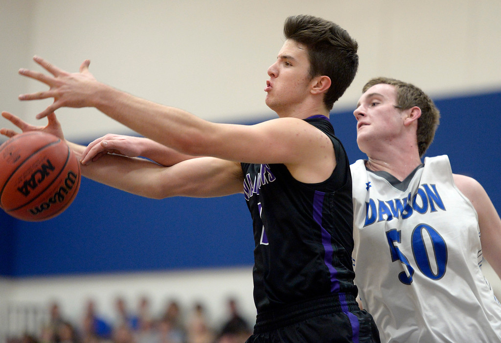 . Longmont Christian\'s Dominic Puchino and Dawson\'s Nick Timms go after the ball in the second quarter Thursday night at Alexander Dawson. To view more photos visit bocopreps.com. Lewis Geyer/Staff Photographer Feb. 16, 2017
