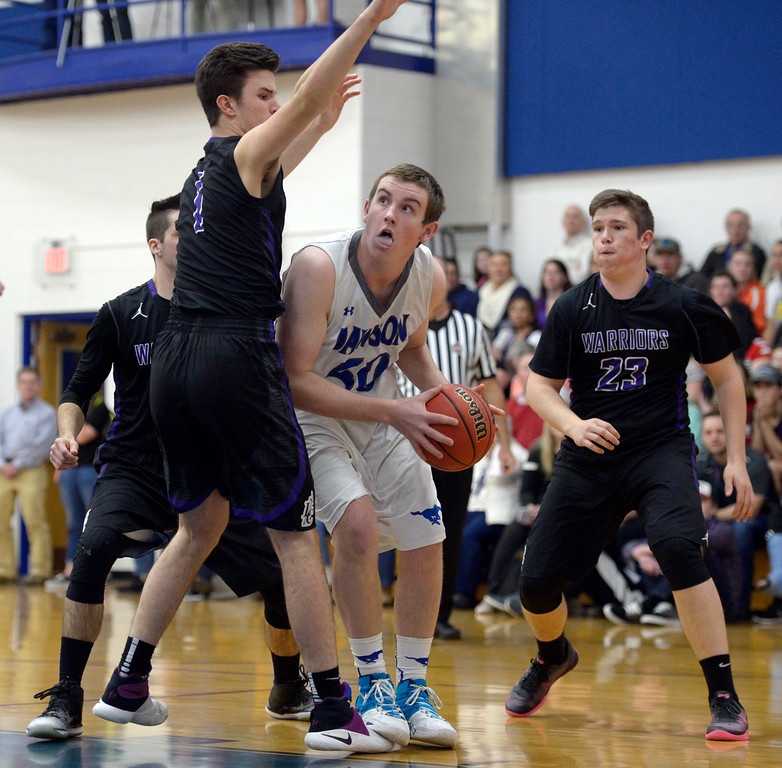 . Dawson\'s Nick Timms looks for a shot as he is covered by Longmont Christian\'s Dominic Puchino in the first quarter Thursday night at Alexander Dawson. To view more photos visit bocopreps.com. Lewis Geyer/Staff Photographer Feb. 16, 2017