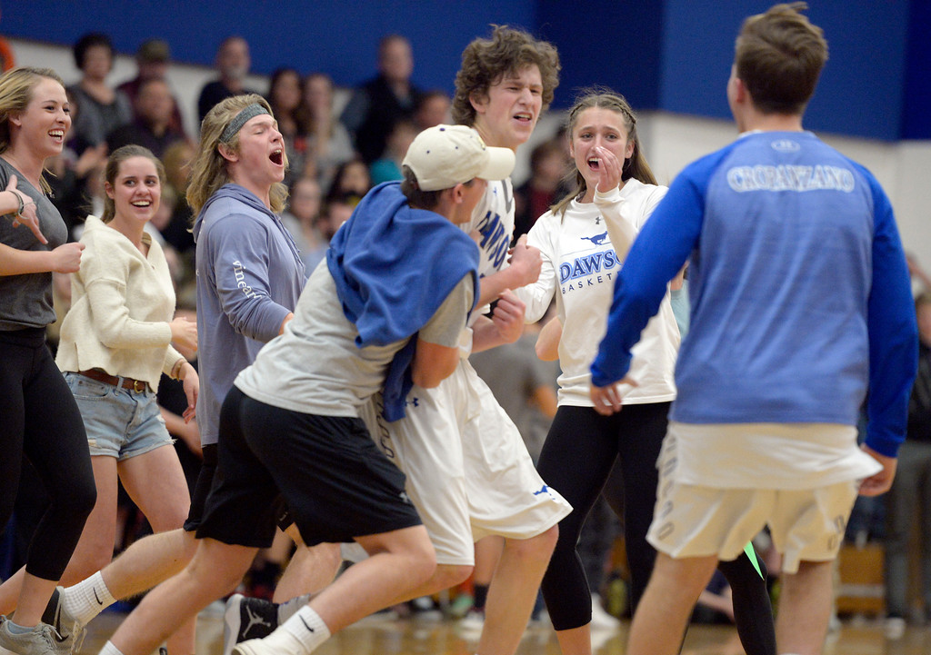 . Dawson\'s Gavyn Pure is swarmed by fans after his team\'s 72-61 win over Longmont Christian Thursday night at Alexander Dawson. To view more photos visit bocopreps.com. Lewis Geyer/Staff Photographer Feb. 16, 2017