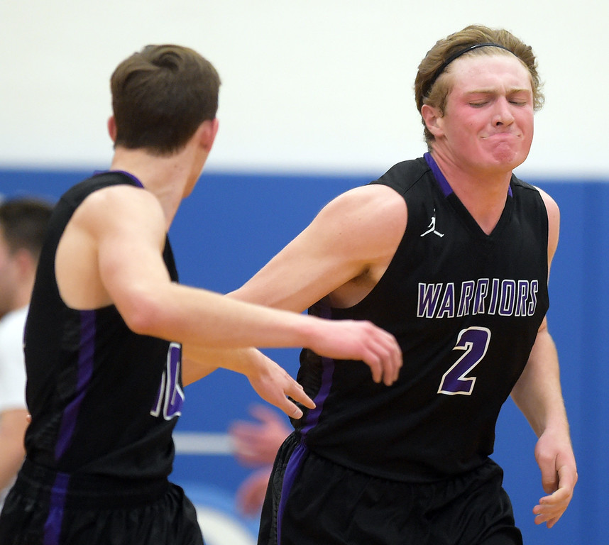 . Longmont Christian\'s Jackson Solem celebrates two points he scored in the second quarter against Dawson Thursday night at Alexander Dawson. To view more photos visit bocopreps.com. Lewis Geyer/Staff Photographer Feb. 16, 2017