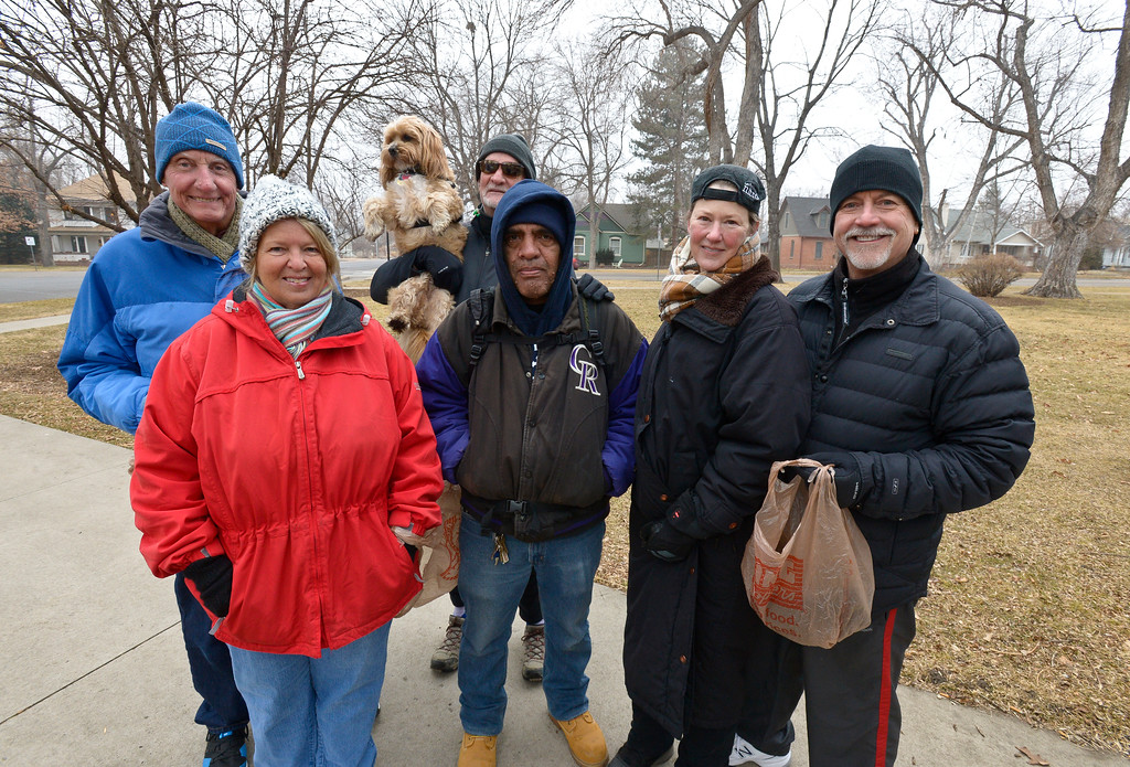 . From left: Bob and Linda McLaughlin, John Lee, Pastor Chris Sandoval, Tracy Kindorf and her husband Richard Showers are members of the Historic East Side Neighborhood Group that gathered to collect trash in Collyer Park Friday morning. To view more photos and a video visit timescall.com. Lewis Geyer/Staff Photographer Feb. 09, 2018