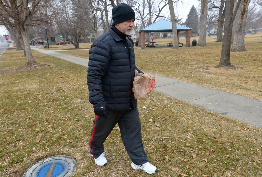 . Richard Showers walks through Collyer Park Friday morning to pick up litter. To view more photos and a video visit timescall.com. Lewis Geyer/Staff Photographer Feb. 09, 2018