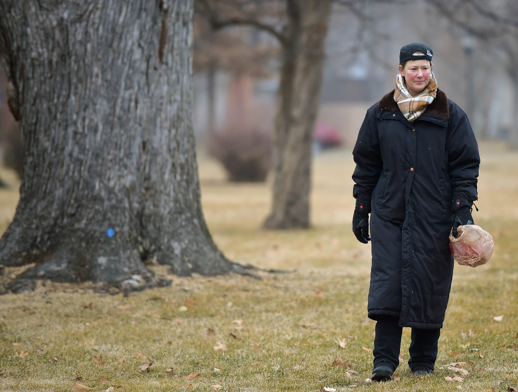 . Tracy Kindorf, a member of the Historic East Side neighborhood group, walks through Collyer Park Friday morning to pick up litter. To view more photos and a video visit timescall.com. Lewis Geyer/Staff Photographer Feb. 09, 2018