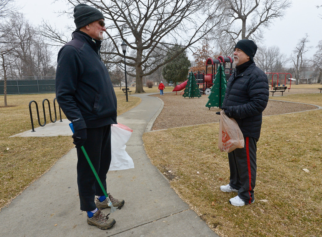 . John Lee, left, and Richard Showers visit while picking up litter in Collyer Park Friday morning. To view more photos and a video visit timescall.com. Lewis Geyer/Staff Photographer Feb. 09, 2018