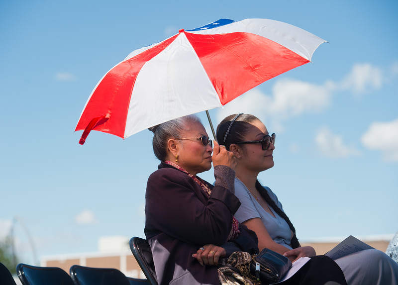 "Kim McCarthy (left) and Felicia McCarthy shade themselves from the sun as they attend graduation for Felicia's son, Alvarez Tutein, at Longmont High School on Saturday.<br /> More photos:  <a href=""http://www.dailycamera.com"">http://www.dailycamera.com</a><br /> (Autumn Parry/Staff Photographer)<br /> May 28, 2016"