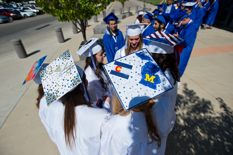 "Seniors line up for graduation outside Everly Montgomery Field at Longmont High School on Saturday.<br /> More photos:  <a href=""http://www.dailycamera.com"">http://www.dailycamera.com</a><br /> (Autumn Parry/Staff Photographer)<br /> May 28, 2016"
