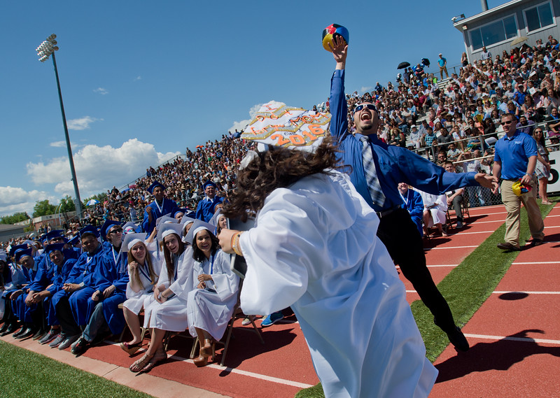 "Jose Soto, a spanish teacher, fails to catch a beach ball as it was being passed around by students during graduation at Longmont High School on Saturday. <br /> More photos:  <a href=""http://www.dailycamera.com"">http://www.dailycamera.com</a><br /> (Autumn Parry/Staff Photographer)<br /> May 28, 2016"