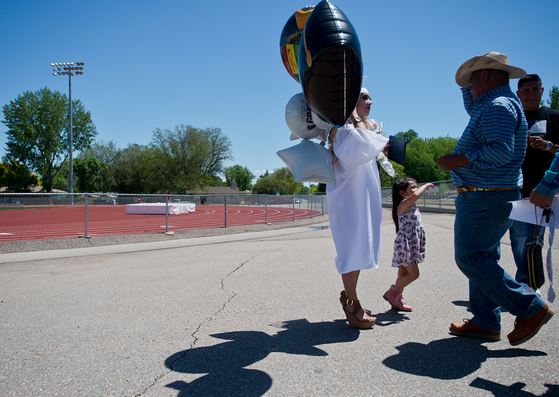 "Kimberly Quiroz waits with balloons in between taking photos with family members after graduation at Longmont High School on Saturday.<br /> More photos:  <a href=""http://www.dailycamera.com"">http://www.dailycamera.com</a><br /> (Autumn Parry/Staff Photographer)<br /> May 28, 2016"