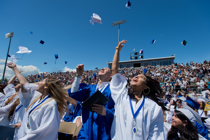 "Juan Carlos Morales (left) and Jeanelle Mora (right) toss their caps in the air at the end of the commencement ceremony at Longmont High School on Saturday.<br /> More photos:  <a href=""http://www.dailycamera.com"">http://www.dailycamera.com</a><br /> (Autumn Parry/Staff Photographer)<br /> May 28, 2016"