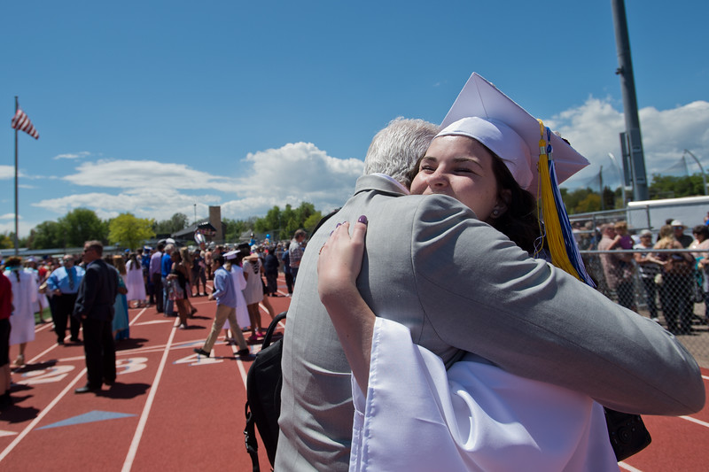 "Madeline Brown receives a hug from her dad, Matt Brown, after graduation at Longmont High School on Saturday.<br /> More photos:  <a href=""http://www.dailycamera.com"">http://www.dailycamera.com</a><br /> (Autumn Parry/Staff Photographer)<br /> May 28, 2016"