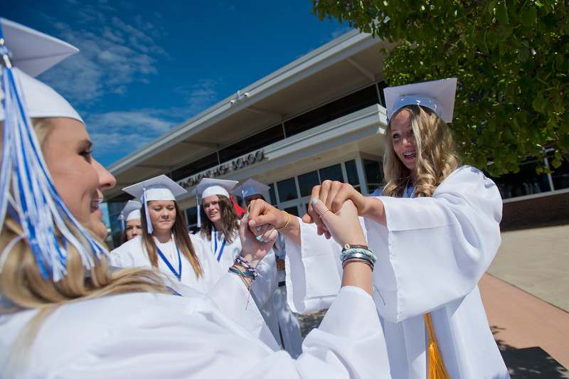 "Samantha Larson (left) holds hands with Sydney Wetterstrom while waiting for graduation to begin at Longmont High School.<br /> More photos:  <a href=""http://www.dailycamera.com"">http://www.dailycamera.com</a><br /> (Autumn Parry/Staff Photographer)<br /> May 28, 2016"
