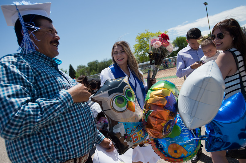 "Kaylee Fontes (center) laughs at her dad, Jesus Fontes, as he tries on her cap after graduation at Longmont High School.<br /> More photos:  <a href=""http://www.dailycamera.com"">http://www.dailycamera.com</a><br /> (Autumn Parry/Staff Photographer)<br /> May 28, 2016"