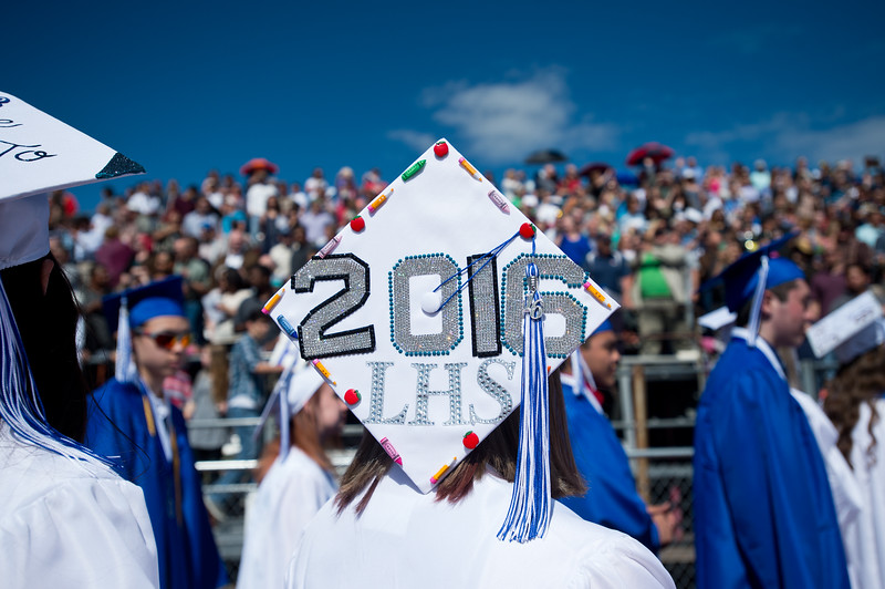 "Seniors pass by the crowd of friends and family as they enter Everly Montgomery Field for graduation at Longmont High School.<br /> More photos:  <a href=""http://www.dailycamera.com"">http://www.dailycamera.com</a><br /> (Autumn Parry/Staff Photographer)<br /> May 28, 2016"