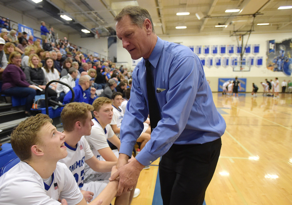 ". Longmont High School boys basketball coach Jeff Kloster shakes hands with his players in the final minute of his 400th win Tuesday night at Longmont High School. ""I love you guys,\"" he said. To view more photos visit bocopreps.com. Lewis Geyer/Staff Photographer Jan. 09, 2018"