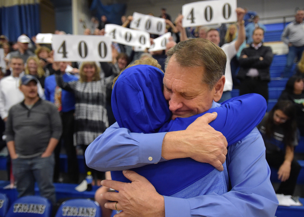 . Longmont High School boys basketball coach Jeff Kloster hugs one of his players after his 400th win Tuesday night at Longmont High School. To view more photos visit bocopreps.com. Lewis Geyer/Staff Photographer Jan. 09, 2018