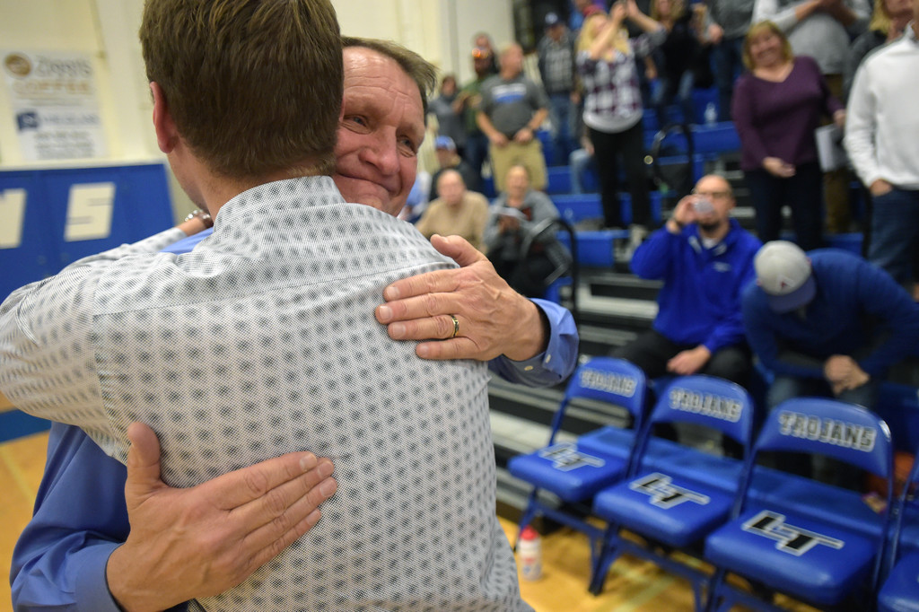 . Longmont High School boys basketball coach Jeff Kloster is hugged by his son Cade Kloster, who is an assistant coach, after Jeff\'s 400th win Tuesday night at Longmont High School. To view more photos visit bocopreps.com. Lewis Geyer/Staff Photographer Jan. 09, 2018