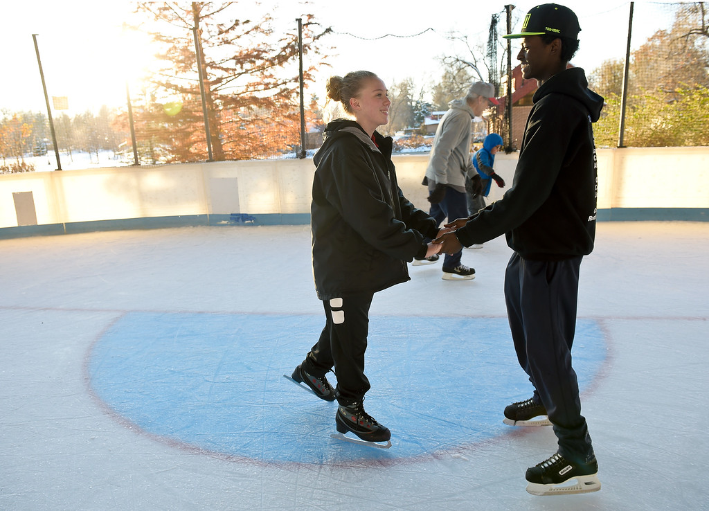 . LONGMONT, CO - NOVEMBER 12: Tyra Stevens and Abenezer Keefer, both 15, skate together at the Longmont Ice Pavilion in Roosevelt Park Nov. 12, 2018. Monday was the first day the skating rink was open for the season. (Photo by Lewis Geyer/Staff Photographer)