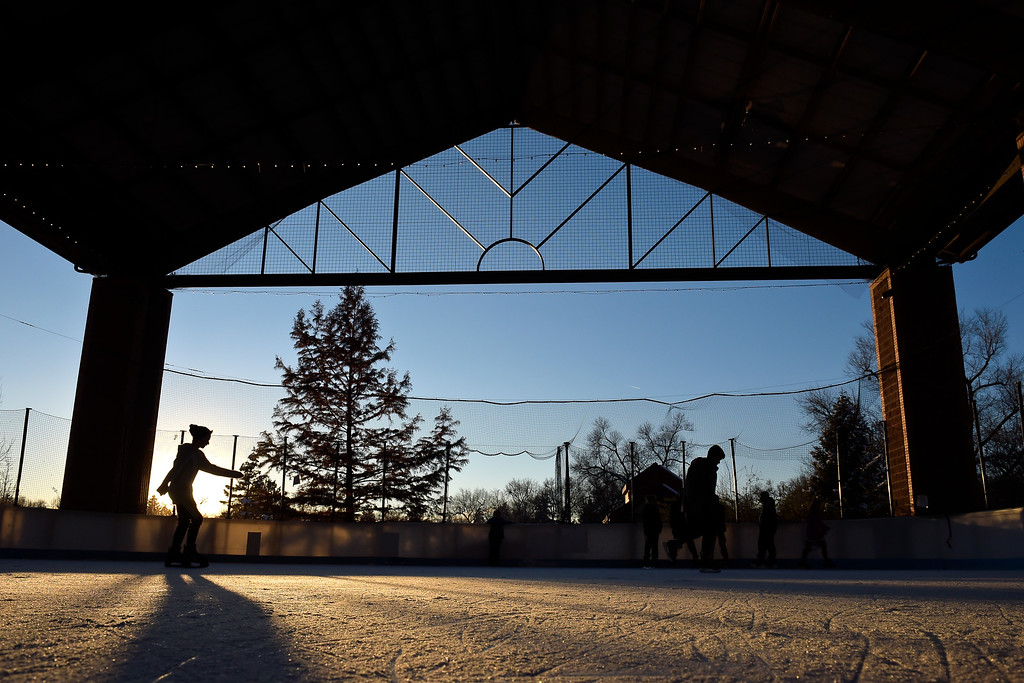 . LONGMONT, CO - NOVEMBER 12: The sun begins to set at the Longmont Ice Pavilion in Roosevelt Park Nov. 12, 2018. Monday was the first day the skating rink was open for the season. (Photo by Lewis Geyer/Staff Photographer)