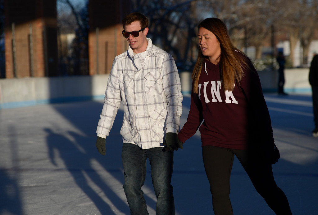 . LONGMONT, CO - NOVEMBER 12: Friends Nathan Rumsey and Kris C. skate together at the Longmont Ice Pavilion in Roosevelt Park Nov. 12, 2018. Monday was the first day the skating rink was open for the season. Kris C. did not want to give her full name. (Photo by Lewis Geyer/Staff Photographer)