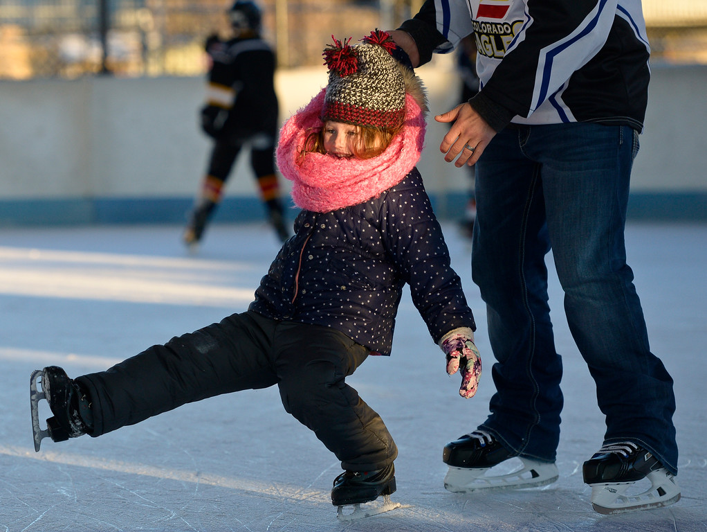 . LONGMONT, CO - NOVEMBER 12: Brynlee Breed, 5, gets a helping hand from family friend Robb Murphy while the pair were skating together at the Longmont Ice Pavilion in Roosevelt Park Nov. 12, 2018. Monday was the first day the skating rink was open for the season. (Photo by Lewis Geyer/Staff Photographer)